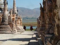 monks running thru pagoda