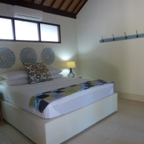 All our rooms are slightly different but have traveler essentials like plenty of power points, good reading lamps & hooks